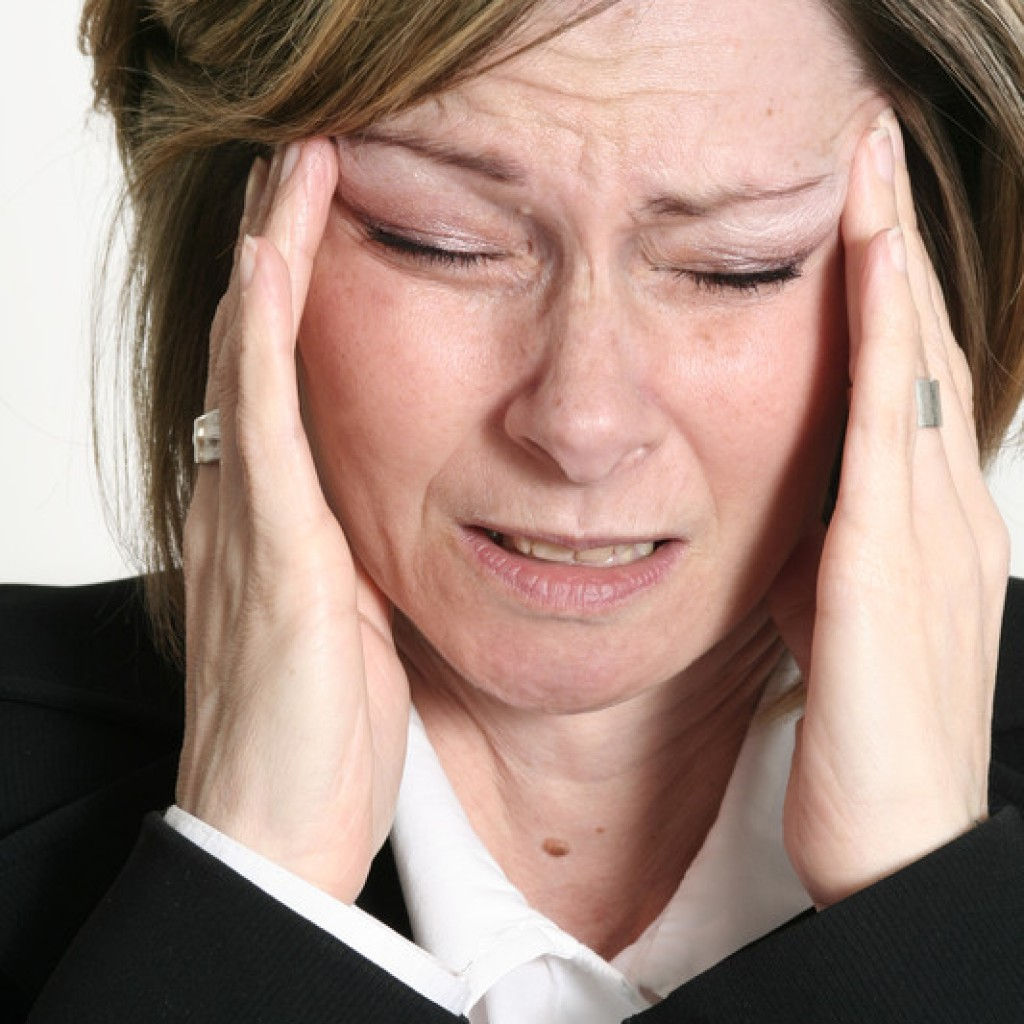 woman with headaches and migraines premenstrual menopause