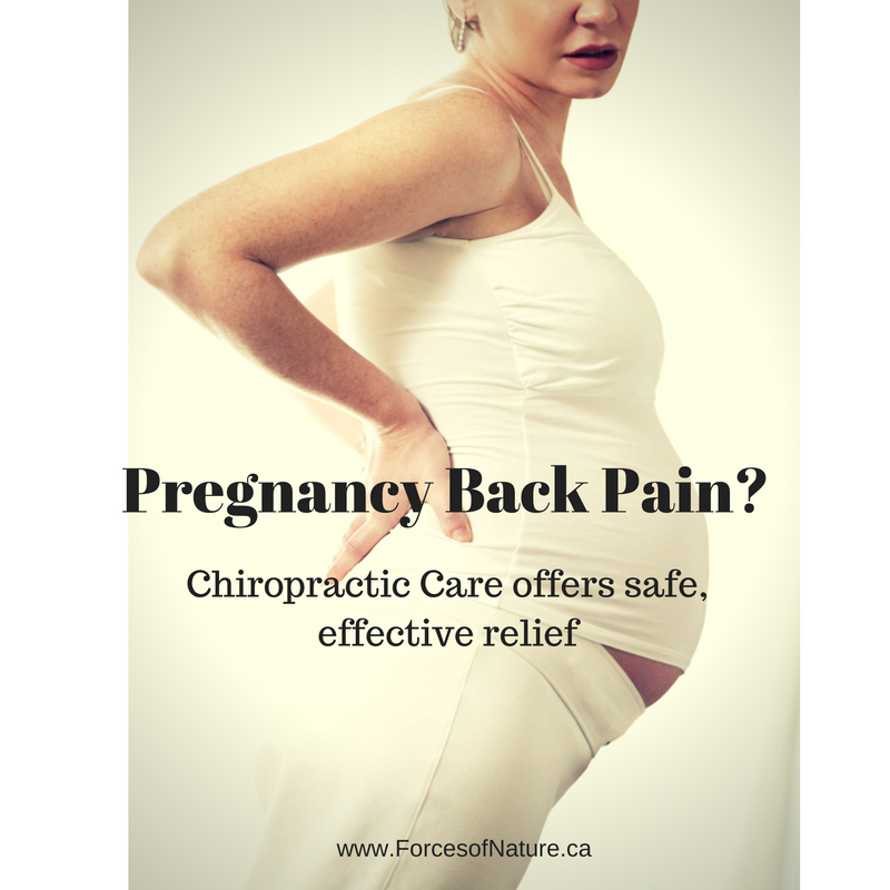 woman experiencing pregnancy back pain