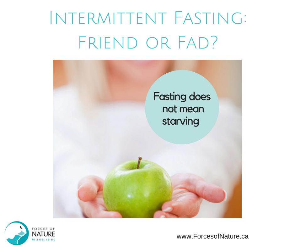 woman holding apple for intermittent fasting