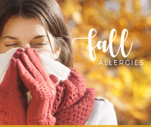 picture of a woman suffering from fall allergy symptoms